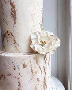 Beautiful gold marble splatter cake from Bake Shoppe Toronto