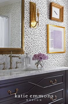 Fun bathroom design featuring gold accents and patterned wallpaper | Katie Emmons Design