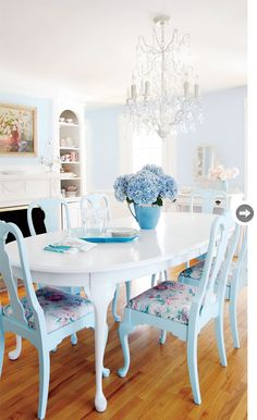blue cottage chairs + white table + crystal chandy