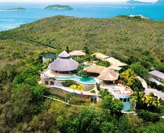 "Yemanja ""Goddess of the Seas"" (to the Brazilians). Located on Mustique Island, Saint Vincent and the Grenadines. The secluded villa is located 300 ft above sea level, covers 7 acres and has a 5 bedroom main house, 3 bedroom cottage, children's house, 3 pools and can cost up to $40,000 a week from December to April!"
