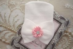 A personal favorite from my Etsy shop https://www.etsy.com/listing/519525963/newborn-hospital-hat-white-with-pink