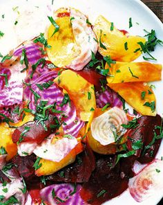 This raw beetroot salad is sexy and seasonal, taking advantage of this season's most beautiful colours & flavours. Get to the local Farmer's market to get these varieties of beets. Remember to marinate the beetroots for a couple minutes to tenderize