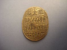 Amulet; bronze; oval. On the obverse: four lines of New Testament narrative imagery and inscriptions. The scenes depicted include (from top to bottom) a haloed face of God in a mandorla held up by angels, an Annunciation to the shepherds, Adoration of the Magi, Christ preaching or healing surrounded by figures and Christ with two figures holding hands under a canopy. On the reverse: winged male figure ... 6thC, www.britishmuseum.org