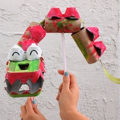 Turn an egg carton, toilet paper rolls, and straws into a cute dragon puppet for Chinese New Year!