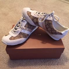 Trendy and unique COACH Kelson laceups These shoes are the most comfortable shoes you'll ever own! They are white and khaki and feature Coach's classic design. They were only worn maybe a total of two times, and are still in great condition! True to size! Box included with purchase! Coach Shoes