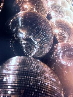 Glitter disco balls - party inspiration for New Year's Eve. Click to shop party dresses by Matthew Williamson