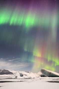 The Northern Lights in Iceland. I'd love to photograph this and make some beautiful chromatic field images!