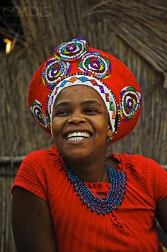 Africa | This Zulu woman wears a red hat which traditionally is the sign of a married woman. Lesedi Cultural Village, South Africa | © Martin Harvey