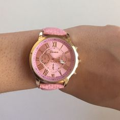 ✨HP✨ Geneva Women's Quartz Pink Leather Watch This watch is brand new and was received as a gift.. It does NOT come with a box, only a plastic sealer.. The material of the wristband is imitation leather.. The wristband color is pink and the screen is pink too.. The time on the watch has not been fixed, so u can adjust it yourself.. the buckle and the little slots for the wristband are very thin.. It's a cute watch for everyday use or even party! HP 2016✨ No trades please Geneva Accessories…