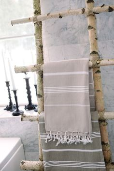 Towel rack of branches and twine