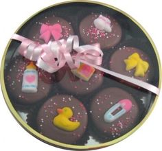 $12.00-$15.00 Baby Our Oreo Cookie assortment contains 7 chocolate covered Oreo cookie. They are drenched in premium milk chocolate and decorated for a baby girl with sugar bows, baby bottles, baby pins, ducks and baby blocks. Comes packaged in a clear round container with gold accents. Tied with a pink and white ribbon. Perfect for any expectant mom, or baby shower favor! Actual Oreo decoration ...