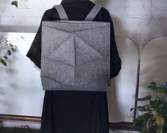 Items similar to Futuristic architectural minimalist design light backpack on Etsy 3d Triangle, New Skin, Custom Bags, Minimalist Design, Wool Blend, Purses And Bags, Backpacks, Trending Outfits, Architecture