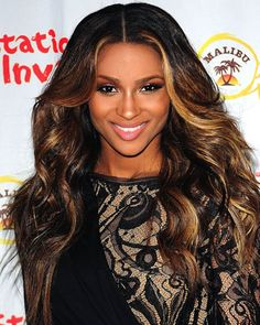 If you have dark hair like Ciara, a glossy espresso look is a beautiful way to play it up. Ask your Spasation stylist for coppery blonde right along your part and hidden streaks on the underside of your hair.