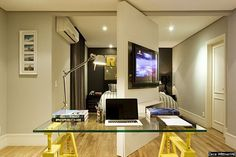 A parede giratória divide o espaço de lazer e estudo, espetacular!!!