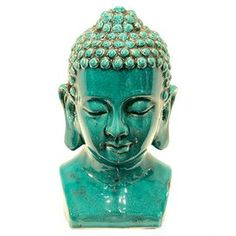 "Ceramic Buddha head statue with crackle glaze.   Product: StatueConstruction Material: CeramicColor: TurquoiseDimensions:  14"" H x 8"" W x 7"" D"