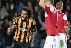 Hull City 6 Fulham 0: On his 27th. birthday,  Tom Huddlestone  of Hull City earns a long-awaited trim after breaking his duck as Rene Meulensteen's Cottagers are humbled. Huddlestone had vowed not to cut his hair until he had scored for the club.