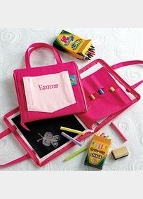 """Adorable cotton carryall that contains everything you need to keep the little ones entertained. Features and Facts: The Doodlebag comes with 24 Crayola crayons, a drawing pad, 12-pack of Crayola chalk, a blackboard and an eraser. Personalize this gift with an embroidered first name (up to 8 characters) on the front pocket Select your thread color from one of David's Bridal Exclusive thread colors. Size: 8"""" x 8"""" . *Note - All personalized items are non-returnable. View Font Options View…"""