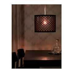 I like this over your dining table to tie into the black counter.  You buy the shade and the cord element separately and put together.  NYMÖ Lampskärm  - IKEA