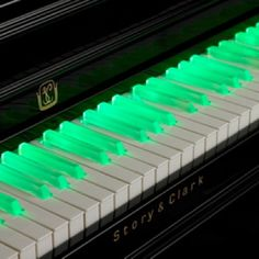 Green illuminated piano keys. #music #piano…