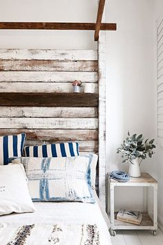 Strips of reclaimed, whitewashed wood lend a rustic touch to the industrial chic aesthetic of this room. Recreate the look with a set of two-by-fours from your local hardware store.