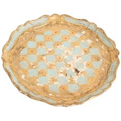 Naveen Round Tray at Found Vintage Rentals. Blue and gold worn wooden tray