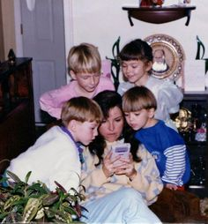 My Mom helping me through a hard level in Super Mario Land on the day Nintendo Gameboy was released.