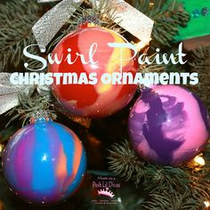 kid made swirl paint christmas ornaments using old/recycled ball ornaments