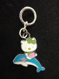 $3 Hello Kitty riding dolphin Charm #614