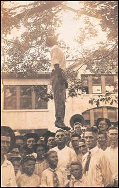 Lynching was very popular in those days, they would hang coloured people if they stood up to someone about being equal with the whites and they would have a public hanging and put a sign on who ever it was they lynched and it would say 'do not move' and the whites would get pictures taken with them.