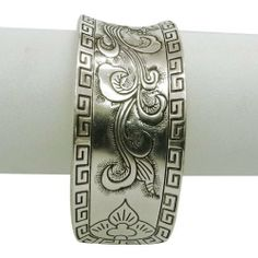 """Iba Silver Tone Adjustable Carved Brass Cuff Embossed Design Bollywood Party Wear Fashion Jewelry Gift IBA. $13.99. Silver Tone Cuff. SALE FOR - 1; MATERIAL - Alloy;. SIZE - 2.5"""" (Adjustable), Cuff Width - 1"""" Inches; COLOR - Silver Tone;"""