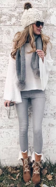 #winter #outfits white sweater wide sleeves, grey jeans. brown boots