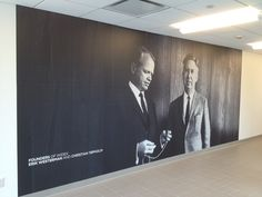 Photography - I absolutely loved the texture on the black wall. Very elegant photos also. Corporate branding. Vinyl wall graphic in build lobby.