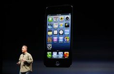 """The world loves iPhone 5, but some say it lacks """"wow"""""""