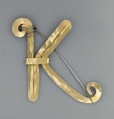 K Brooch | Alexander Calder. Gold and steel wire. ca 1963. | Sold by Christies London, on 10th February 2005 for GBP 28,800