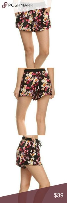 💐Black floral print shorts 💐 SERIOUSLY CUTE 😊 black floral print shorts , very lightweight & comfortable, & so flattering, features soft elasticized drawstring waistband , side slit pockets , fabric is %100 rayon shosho Shorts