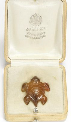 A jewelled agate miniature figure of a turtle Fabergé, St. Petersburg, c.1900 an exquisitely carved miniature figure of a baby turtle, the top realistically carved to simulate the texture and look of the tortoise shell, the feet carved with minute details, the eyes set with rose-cut diamonds; in fitted original wooden box lined with cream velvet and stamped with Fabergé firm insignia length: 2.7cm (1 1/8in).