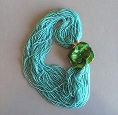 "Original by Robert Aqua Bead 42-strand  Necklace ""...enameled flower catch backed with gold tone metal..."" http://www.morninggloryjewelry.com/original-robert-aqua-bead-42strand-necklace-p-13293.html"