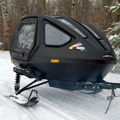 Snowcoach - seats two w/seatbelts-enclosed capsule for kids - my daughter w/Down Syndrome loves the ride behind us!