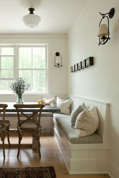 I really like the idea of a built in bench for a kitchen table with chairs on one side. The designer has two tips: 1. Make sure the back has a pitch for comfort, and 2. Have the carpenter create a lip to hold the cushions in place to prevent sliding.