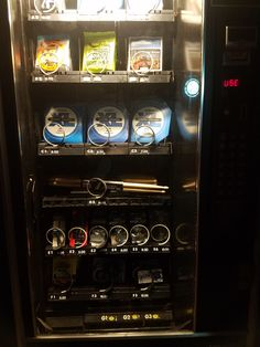 This bar/venue has a vending machine that sells guitar strings picks drum sticks and other music equipment.