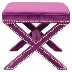"""Wrapped in sumptuous plum upholstery, this nailhead-trimmed ottoman adds a hint of glamour to your decor.   Product: OttomanConstruction Material: Polyester and woodColor: PlumFeatures: Nailhead trim detailingGreat addition to any roomDimensions: 19"""" H x 21.5"""" W x 21.5"""" D"""