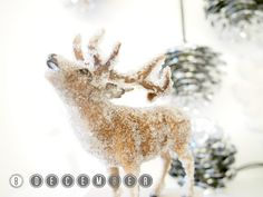 A frosted deer using glue and small glass beads - amazing!