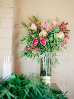 Photographed by Elyse Hall, this colorful same sex wedding took place in the Arizona desert surrounded by cacti and gorgeous views! Wildflower Centerpieces, Wedding Centerpieces, Wild Flowers, Deserts, Floral Wreath, Vibrant, Wreaths, Table Decorations, Guest Ranch