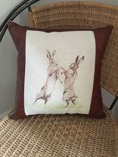 A personal favourite from my Etsy shop https://www.etsy.com/uk/listing/480365447/boxing-hares-scatter-cushion-with