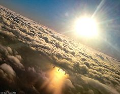 Need another reason to book a window seat? Just take a look at the Chicago skyline reflected in Lake Michigan, as seen from this airplane window