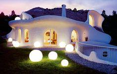 Modern Hobbit houses in Switzerland by Vetsch Architektur