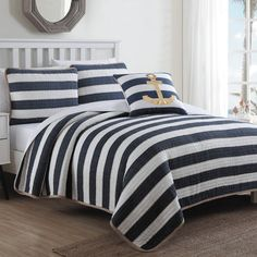 Features:  -Imported.  -Pre-washed: Yes.  Product Type: -Quilt/Coverlet set.  Style (Old): -Coastal.  Color: -Navy blue, white and brown.  Pattern: -Solid/Striped.  Material: -Cotton.  Cleaning Method