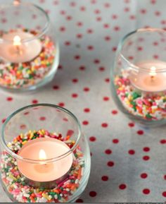 Here's another fun and unexpected place to add the sprinkle theme: in tiny jars underneath votive candles. So simple, so cute!