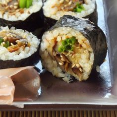 Spicy eggplant sushi made with tender eggplant strips that are pan-fried in garlic and chili paste and rolled up with sushi rice and nori.