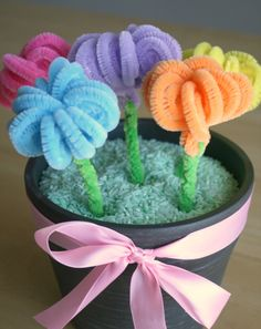 I first saw these pipe cleaner flowers done by Kami at No Biggie. She shared how to make them into fun rose rings, but I thought I'd put my own little twist on them for a Mother's Day Bouquet. You can bind them together all on their own or place them in a flower pot …